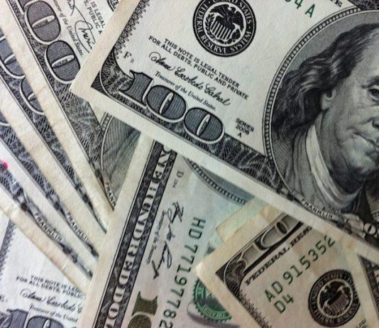 Tekort aan contante US dollar biljetten in Suriname; banken adviseren girale overmakingen