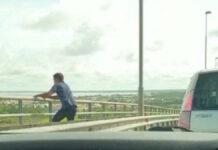 Verontrustend filmpje van jongeman die van Bosje brug af lijkt te springen