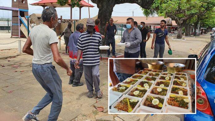 Daklozen in Suriname krijgen warme maaltijd en drank