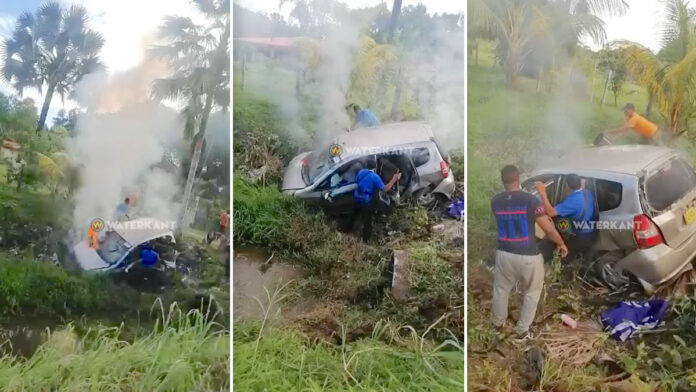 VIDEO: Omstanders blussen beginnende brand auto na verkeersongeval