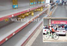 Drukte en lege schappen bij winkels in Suriname