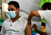 Minister Amar Ramadhin van Volksgezondheid vaccinatie covid-19 suriname